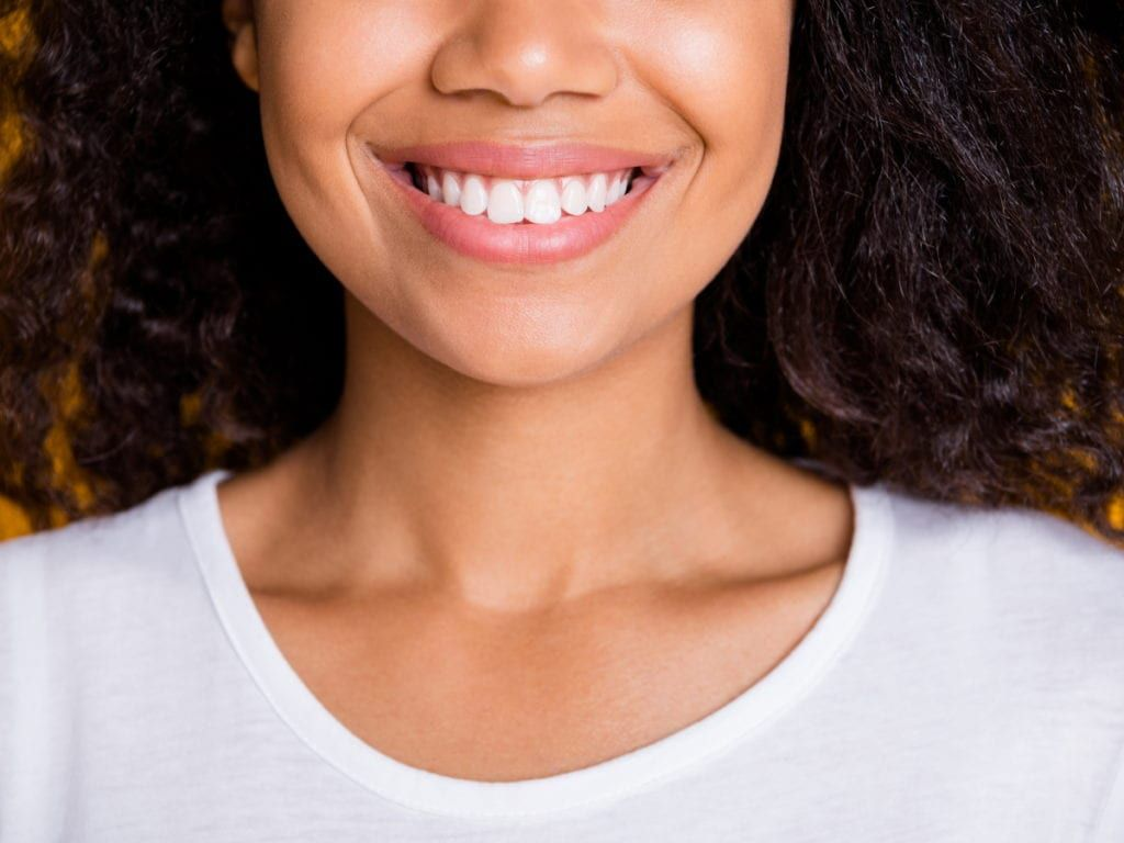 Woman with no gaps in smile